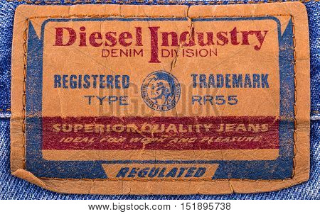 Kamchatka Russia - October 14 2016: Closeup of Diesel 's leather jeans label isolated on white background. Diesel - Italian design company and brand clothing and accessories