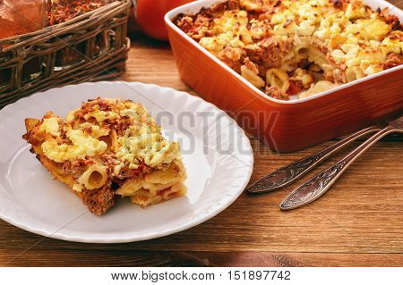Pastitsio -greek casserole with pasta, meat, tomatoes and feta cheese.