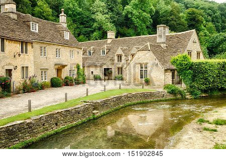 A large villa in Castle Combe village with a spacious yard and a creek next to it.