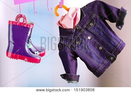 multi-colored rubber boots for kids hanging with jeans denim jacket