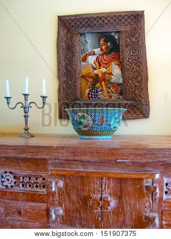 Bali, Indonesia - April 11, 2012: View of wooden furniture, painting, a work of art at Tanah Merah Art Resort