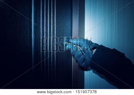 man in gloves opens the door Close up. thief and hacking concept