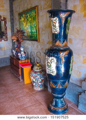 Bali Indonesia - April 11 2012: View of wooden furniture painting a work of art at Tanah Merah Art Resort