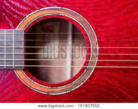 acoustic guitar sound hole red wood close up shot