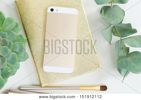 Back of the phone with golden woman accessories mock up flat lay styled scene, top view, copy space on empty screen background