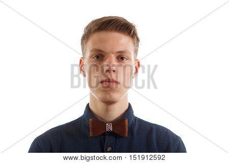 A man wearing a blue shirt and a wooden bowtie