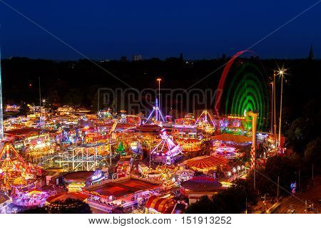 NOTTINGHAM ENGLAND - OCTOBER 5: Goose Fair. The 'Mach 5' ride to right of image. In Nottingham England. On 5th October 2016.