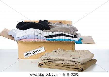 Clothes donation box with white in background
