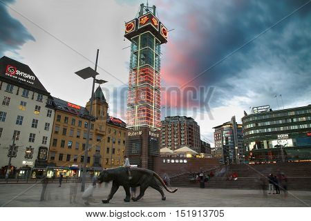OSLO NORWAY - AUGUST 17 2016: Many people walking on wonderful Plaza in front of Oslo Central station at twilight in Oslo Norway on August 172016.