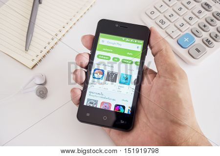 PHUKET, THAILAND - AUG 21 2016 - Hand man holding smartphone mobile with Google play application on android screen