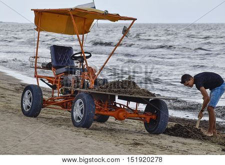 The Car For Garbage Collection From The Beach. Cleaning On The Beach, Clean Beach From Mud And Waste
