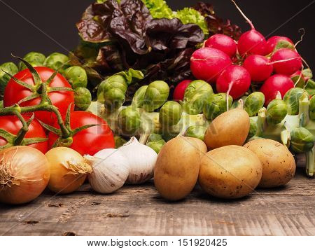Fresh vegetables on a rustic wooden table healthy eating concept