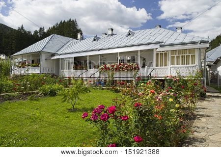 Traditional romanian house with nearly flower garden