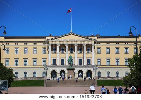 OSLO NORWAY - AUGUST 17 2016: Tourist visit The Royal Palace and statue of King Karl Johan XIV Oslo is the capital city of Norway in Oslo Norway on August 172016.