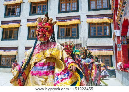 LAMAYURU, INDIA - JUNE 17, 2012: Buddhist monks dancing Cham mystery during Yuru Kabgyat festival in Lamayuru Gompa in Ladakh, Jammu and Kashmir, North India