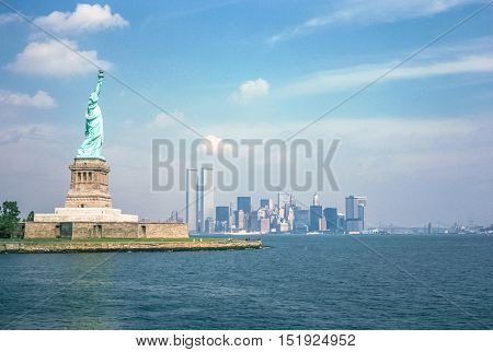 Statue of Liberty and Twin Towers, destroyed in September 11, 2001, of World Trade Center. New York City skyline view from the ferry boat. Symbols NYC, United States.