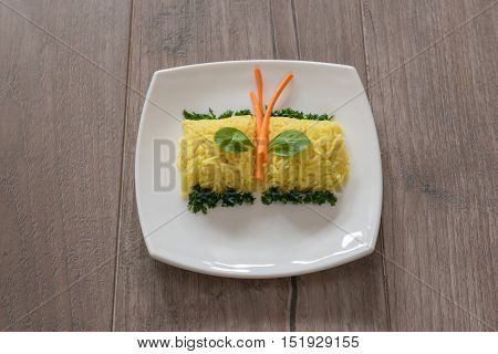 Yellow rice with saffron and vagetables. Indian Cuisine