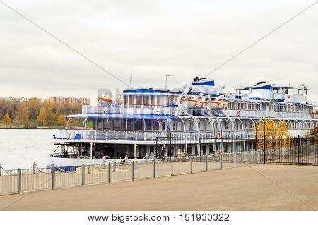 Passenger motor ship in the river dock