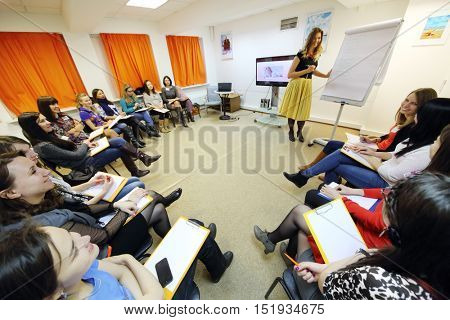 MOSCOW - MAR 26, 2015: Stylist Ekaterina Panyutischeva (with model release) and students at Disclosure of feminine style training