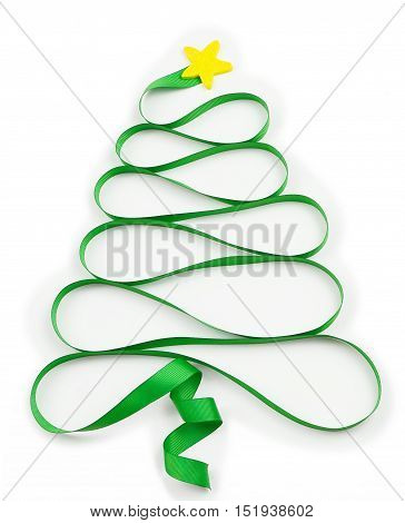 A cutout yellow star sits atop a swirling green ribbon that curls into a Christmas tree shape on a white background.