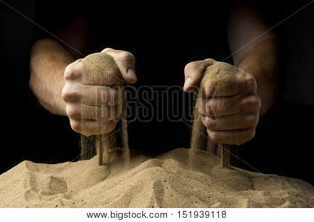 sand in the fray with their fists on the black background