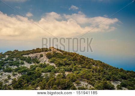 Beautiful landscape with a little house in rocky mountains on the western part of Mallorca island, Spain. Tramuntana mountains with forest. Tourist trekking destination in Spain. Travel timelapse of a landmark.