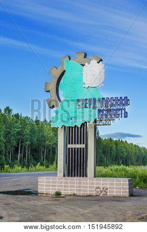 SVERDLOVSK OBLAST RUSSIA - JULY 24 2014: Stella at the entrance to the Sverdlovsk region on the border of Sverdlovsk oblast and Perm Krai