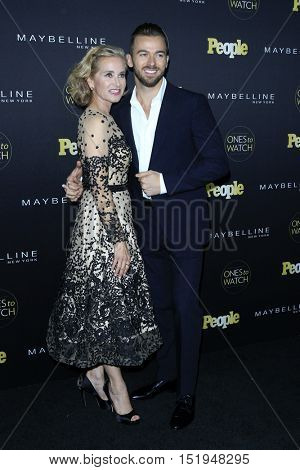 LOS ANGELES - OCT 13:  Maureen McCormick, Artem Chigvintsev at the People's One to Watch Party at the E.P. & L.P on October 13, 2016 in Los Angeles, CA