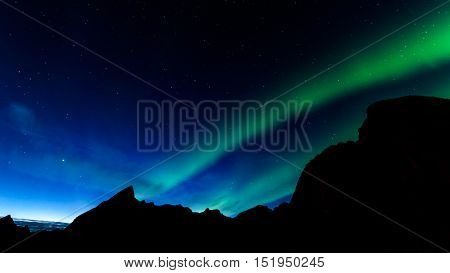 A beautiful green Aurora borealis or northern lights in Norway