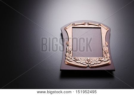 Wood Plaque and Metal Plate on black background