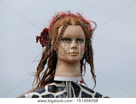 A Hippy Hairstyle of a Female Mannequin Model Head.