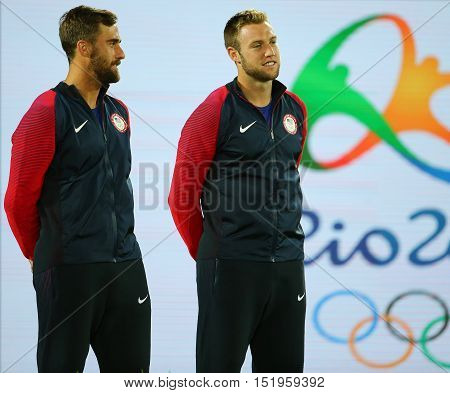 RIO DE JANEIRO, BRAZIL - AUGUST 12, 2016: Bronze medalists Steve Johnson (L) and Jack Sock of United States during medal ceremony after men's doubles final of the Rio 2016 Olympic Games