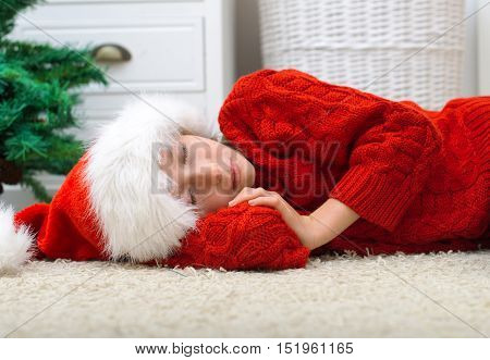 Little girl was waiting for Santa Claus and fell asleep.