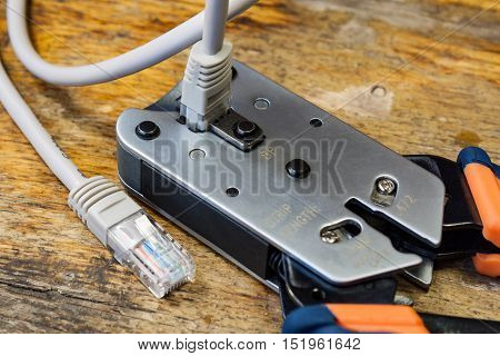 Crimping tool for mounting of the connectors RJ45 on the desktop in a workshop