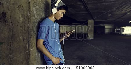Teenager Style Listening Music Headphone Street Concept