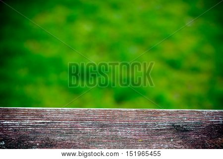 Old wood fence with a green field behind - shallow depth of field
