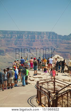 GRAND CANYON VILLAGE AZ - AUGUST 19: Crowded with people view point at the Grand Canyon National park on August 19 2015 in Grand Canyon Village AZ.