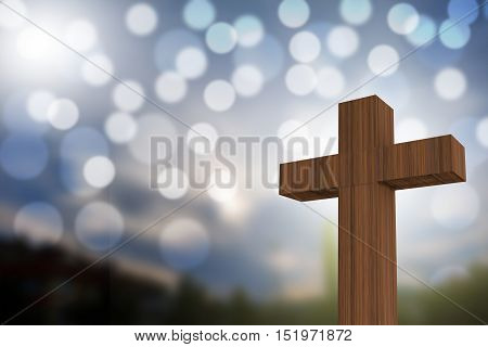 3D Rendering Of Wooden Cross On A Blue Sky With Sunlight And Bokeh