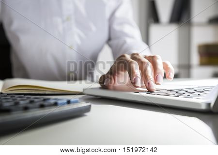 Close up of beautiful woman's hand typing on laptop keyboard. Concept of personal assistant's work