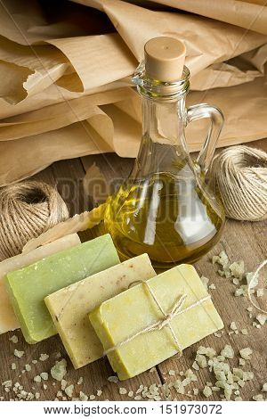 Collection of handmade, natural organic soap and cosmetic oil on wooden background. Spa products.