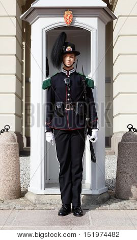 Oslo, Norway - September 16, 2016: One female royal guard soldier in front of a sentry box at the royal palace in Oslo Norway.