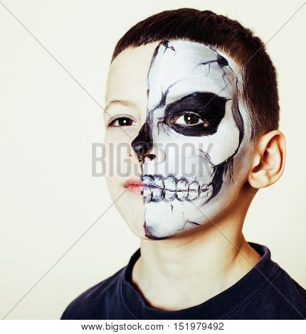 little cute boy with facepaint like skeleton to celebrate halloween, holiday paople concept lifestyle close up