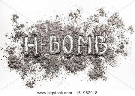 Atomic hydrogen bomb word as war weapon concept written in ash dust dirt