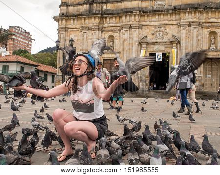 Bogota Colombia - April 30 2016: Pigeons sitting on a tourist was on Bolivar Square in Bogota