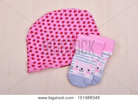 Baby goods. Baby blouse and pants sliders pijama on the clothespin on the rope on a wooden background