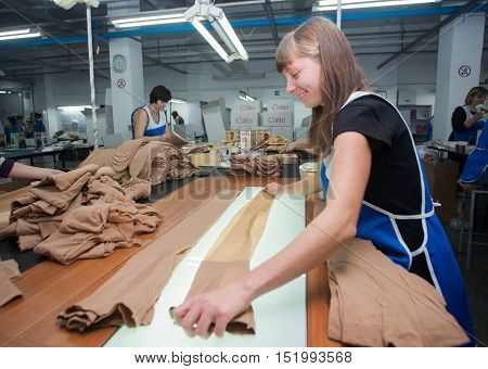 GRODNO BELARUS - DECEMBER 13 2013: women at factory on production of panty hoses .
