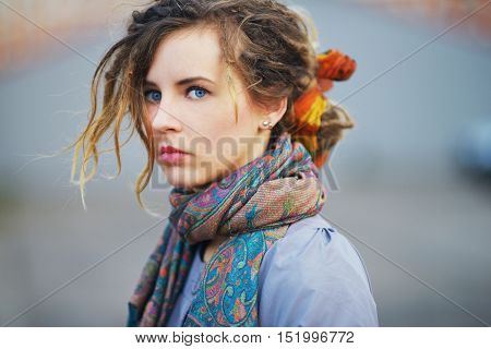 Portrait of beautiful Slavonic girl with dreadlocks and a kerchief, closeup
