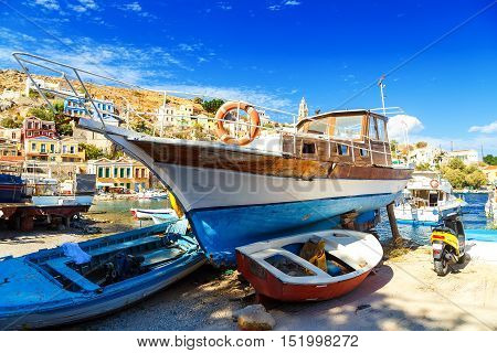wooden boat on seashore, old ship on stocks, Fisher boat on the sea, old wooden boat on beach, old wooden boat in greece, Sailing boats in traditional shipyard in Greece
