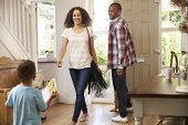 Father Opens Front Door For Mother Returning Home From Work poster