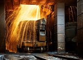 Liquid iron from ladle in the steelworks poster